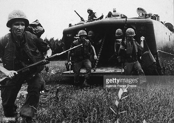 US troops disembark from a truck during the Vietnam War 1967