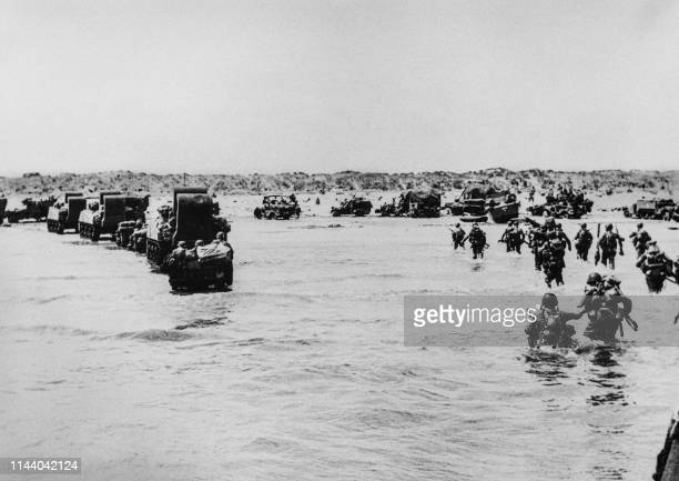 US troops disembark from landing crafts during DDay 06 June 1944 after Allied forces stormed the Normandy beaches DDay 06 June 1944 is still one of...