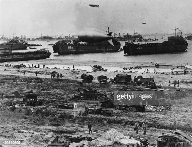 Troops disembark from landing crafts during D-Day 06 June 1944 after Allied forces stormed the Normandy beaches. - D-Day, 06 June 1944 is still one...