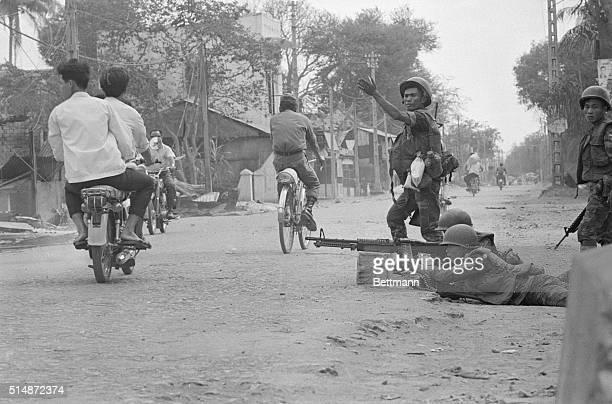 Troops Encircle Vietcong Hideout