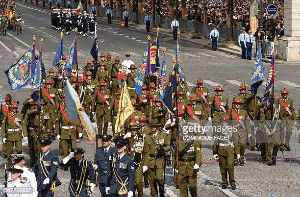Troops from Australia and NewZealand arrive Place de la Concorde as they take part in the annual Bastille Day military parade on the ChampsElysees...