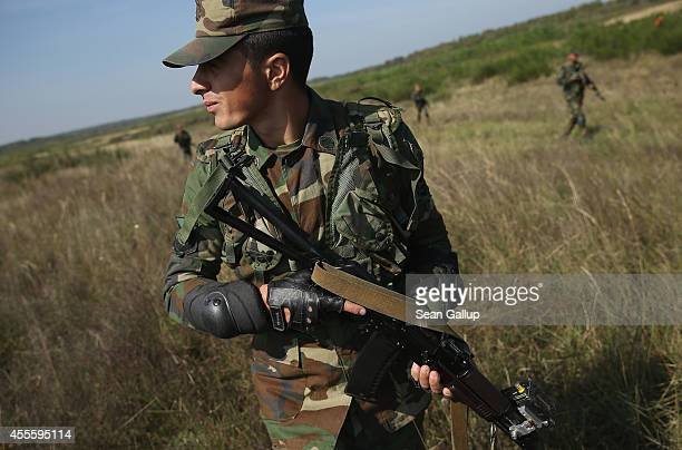 Troops from Azerbaijan move forward in an attack on US soldiers on the third day of the 'Rapid Trident' bilateral military exercises between the...