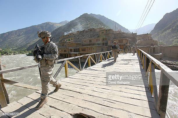 Troops from Charlie Company US Army's 10th Mountain Division patrol through the town of Barge Matal Nuristan province
