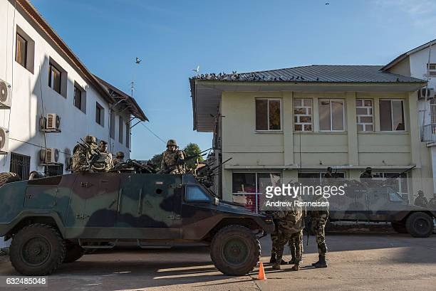 Troops from Senegal gather outside the Gambian statehouse on January 23, 2017 in Banjul, The Gambia. ECOWAS is in Gambia to ensure a safe transition...