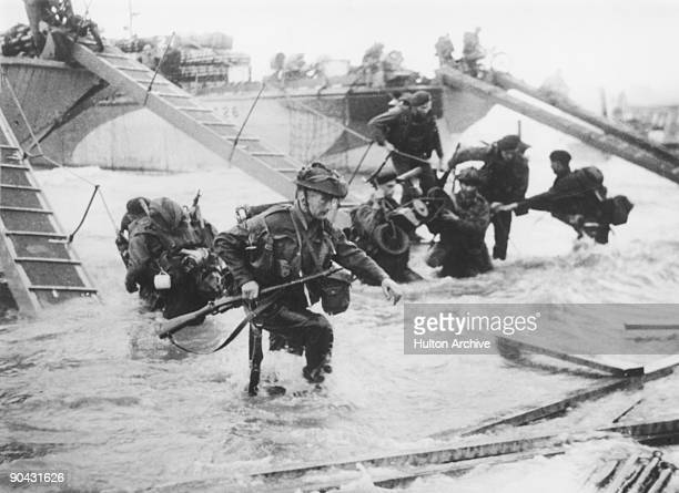 Troops from the 48th Royal Marines at SaintAubinsurmer on Juno Beach Normandy France during the DDay landings 6th June 1944