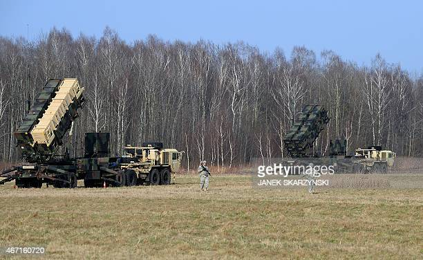 US troops from the 5th Battalion of the 7th Air Defense Regiment emplace a launching station of the Patriot air and missile defence system at a test...