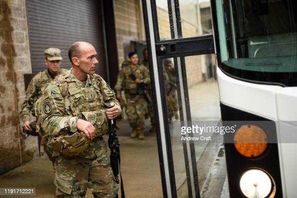 S troops from the Army's 82nd Airborne Division board a bus as they head out for a deployment to the Middle East on January 4 2020 in Fort Bragg...