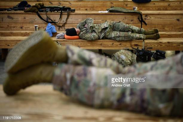 S troops from the Army's 82nd Airborne Division get some rest at Green Ramp before they head out for a deployment to the Middle East on January 4...