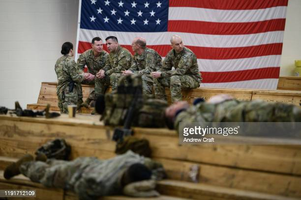 S troops from the Army's 82nd Airborne Division wait at Green Ramp before they head out for a deployment to the Middle East on January 4 2020 in Fort...