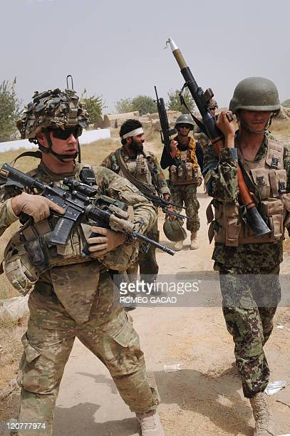 US troops from the Battle Co 132 Infantry Battalion 3rd Brigade Combat Team and Afghan National Army soldiers patrol the Mullah Omar mosque partly...