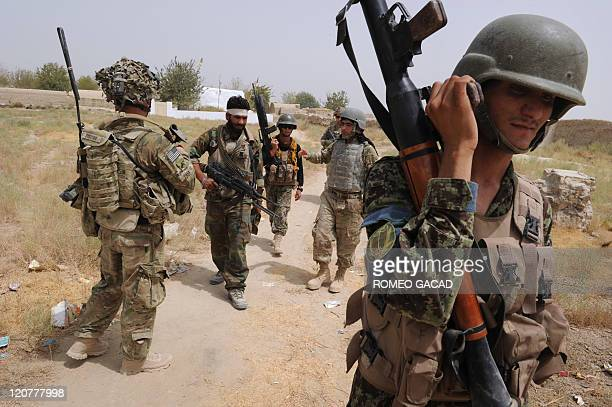 US troops from the Battle Co 132 Infantry Battalion 3rd Brigade Combat Team and Afghan National Army soldiers patrol the Mullah Omar mosque white...