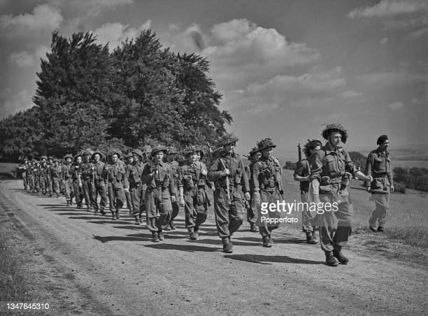 Troops from The Royal Air Force Regiment take part in a 60 hour march as part of a battle course from their training base in England during World War...
