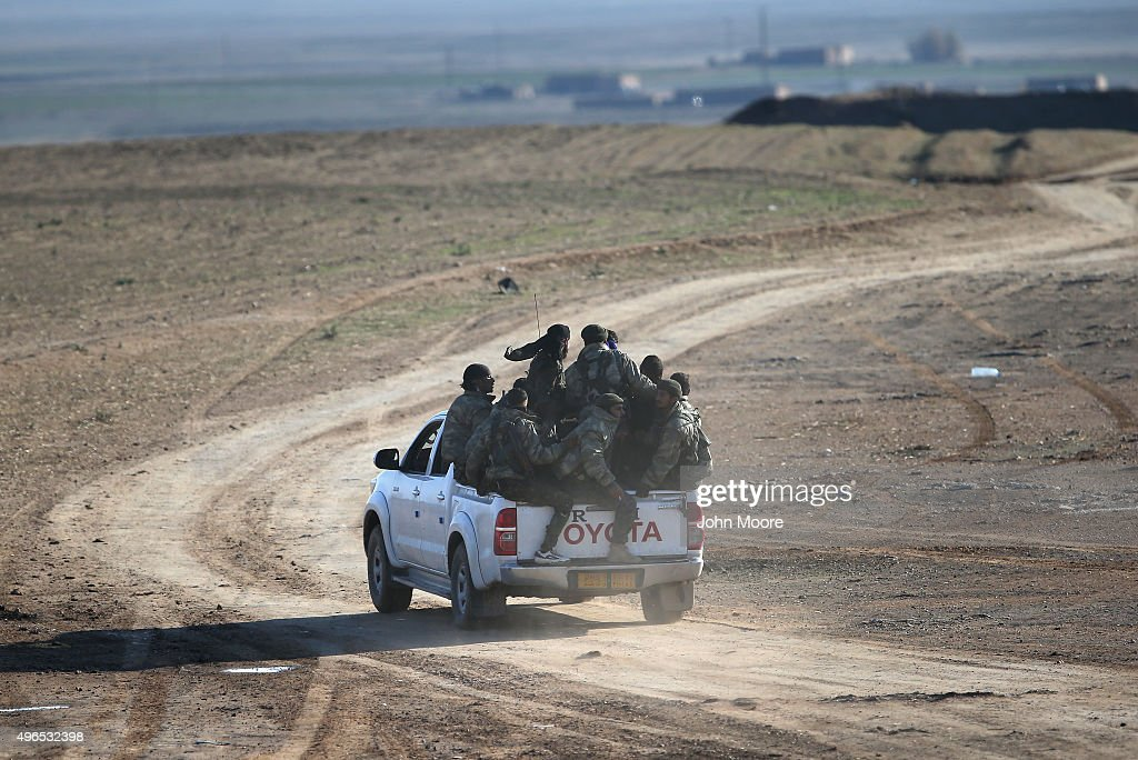 Troops from the Syrian Democratic Forces head to the frontline on November 10, 2015 near the ISIL-held town of Hole in the autonomous region of Rojava, Syria. The forces, a coalition of Kurdish and Arab units, are attacking ISIL extremists in the area near the Iraqi border. The predominantly Kurdish region of Rojava in northern Syria has become a bulwark against the Islamic State. Their mostly Kurdish armed forces, with the aid of U.S. airstrikes and weapons, have been battling ISIL, who had earlier captured much of the region from the Syrian regime.