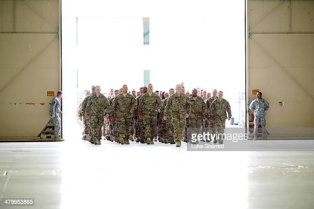 Troops from the U.S. Army's Battery B, 2nd Battalion, 44th Air Defense Artillery Regiment, 101st Airborne Division, arrive at a homecoming ceremony...