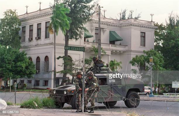 Troops guard the Vatican embassy in Panama City during Operation Just Cause, on December 25, 1989 as Panamanian General Manuel Noriega remains under...