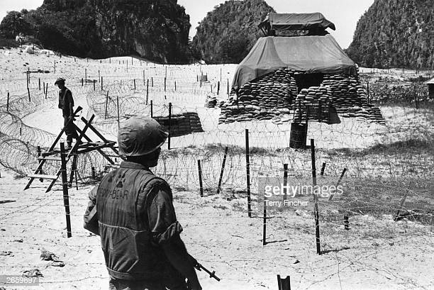 US troops guarding defences near Hui Kinson Vietnam