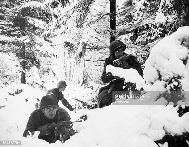 US troops in a snow covered forest during the Battle of the Bulge Belgium ca 1944
