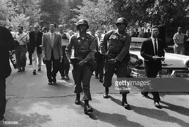 US troops in a street in Little Rock Arkansas where they are helping to enforce the nation's first school desegregation at Central High School...