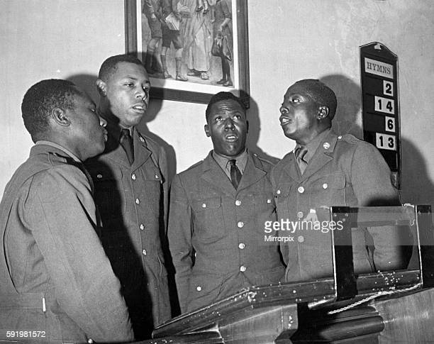 US troops in England during the Second World War Black American troops singing spiritual songs at Great Doddington Northamptonshire during a church...
