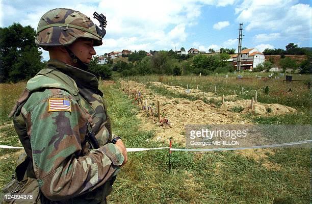 NATO troops in Kosovo In Yugoslavia On June 14 1999 US soldier in front of Presumed mass grave in Kacanik