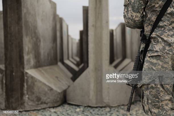 Troops inspect hundreds of concrete T-walls at Forward Operating Base Howz-e-Madad, in Zhari district, Kandahar, southern Afghanistan, March 2, 2011....