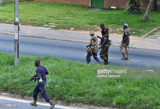 Troops loyal to Alassane Ouattara walk along a street in Abidjan on April 1 2011 Ivory Coast strongman Laurent Gbagbo's forces repulsed an offensive...
