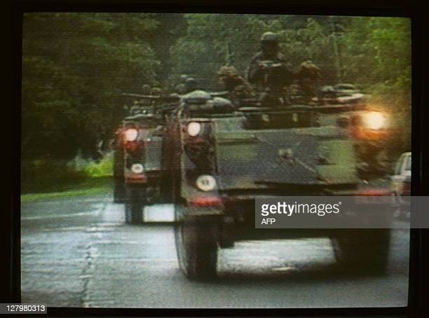 US troops move through Panama City early December 20 1989 after President George Bush ordered US forces to intervene in Panama and apprehend...