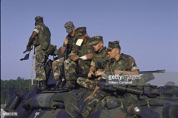 Troops of 2nd Marine Division Light Armored Infantry unit from Camp Lejeune at Cherry Point Marine Corps Air Station preparing prior to being air...