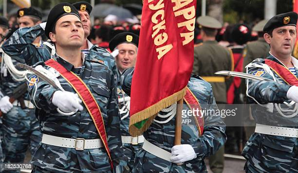 Troops of Georgia's rebel region of Abkhazia march during a military parade to mark the 20th anniversary of Abkhazias de facto independence in the...