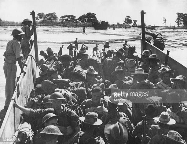 Troops of the 15th Indian corps land on Ramree Island off the coast of Burma during the Second World War February 1945