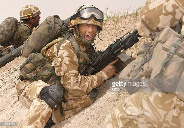Troops of the 1st Royal Regiment of Fusiliers provide cover for members of the 39 Engineer Squadron and 32 Armoured Engineers as they breach one of...