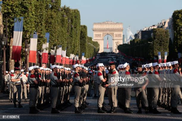Troops of the 3e regiment etranger d'infanterie prepare to take part in the annual Bastille Day military parade on the ChampsElysees avenue in Paris...