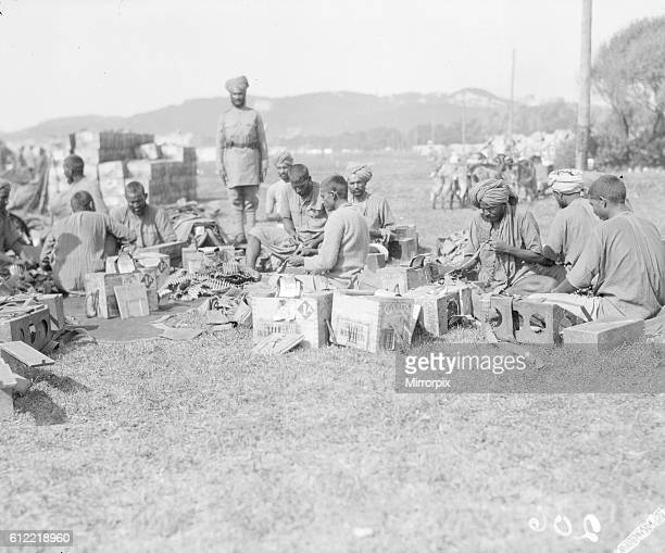 Troops of the 3rd Lahore Indian Division prepare to move up to the front from their rest camp in Marseilles Soldiers are seen here loading bullets in...