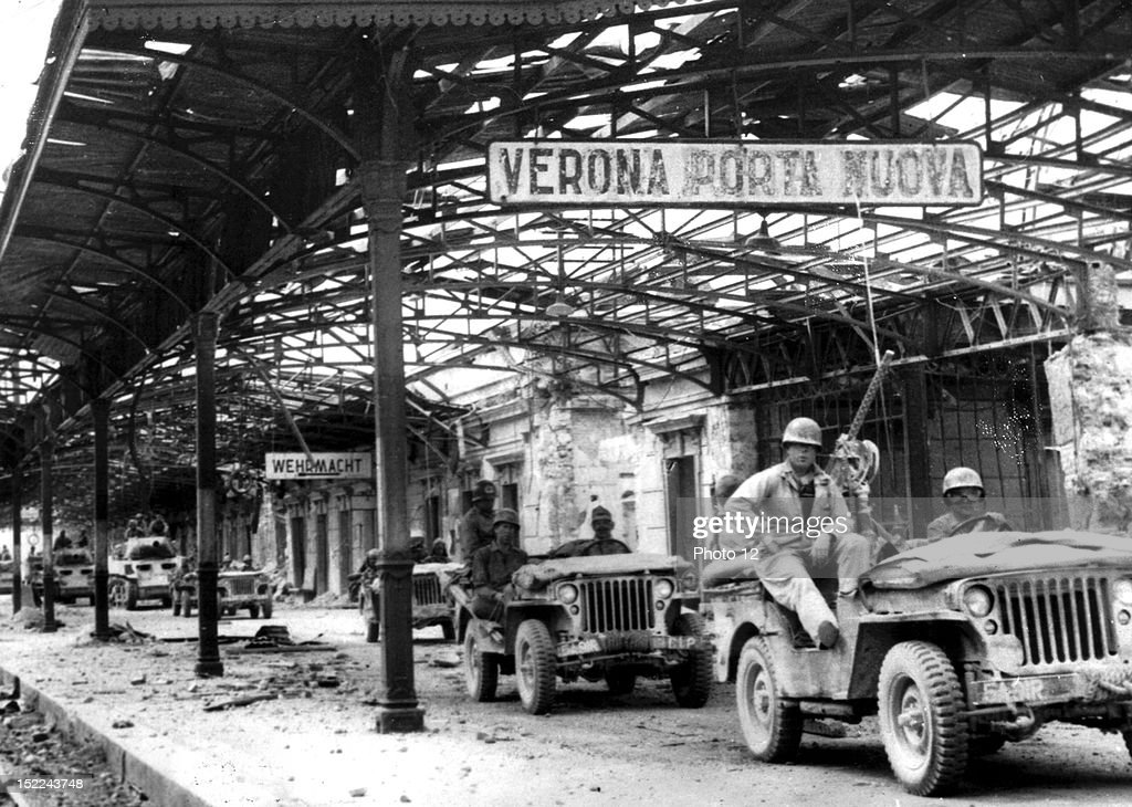 US troops of the 5th Army move through the battered railroad station at Verona : News Photo