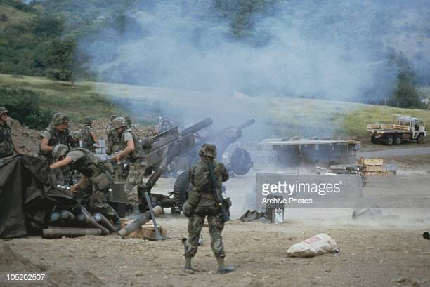 US troops of the 82nd Airborne artillery firing M102 howitzers during the US invasion of Grenada 3rd November 1983 The invasion was codenamed...