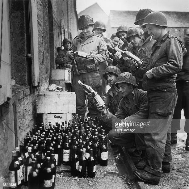 Troops of the American 4th Division find a store of wine left behind by retreating German forces in Cherbourg France 5th July 1944