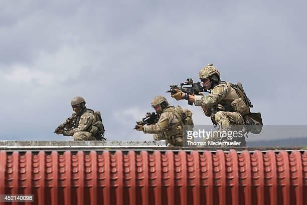Troops of the elite KSK unit demonstrate their skills at a Bundeswehr base during the visit of German Defense Minister Ursula von der Leyen on July...