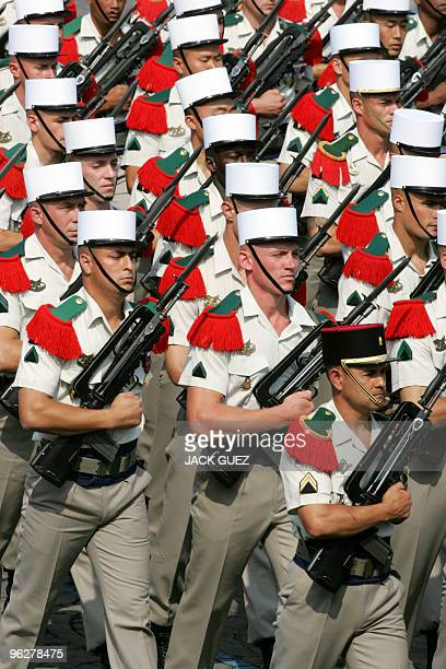 Troops of the French Foreign Legion parade down the Champs Elysees during the Bastille Day military parade 14 July 2006 in Paris AFP PHOTO JACK GUEZ
