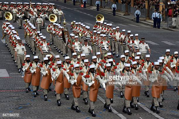 Troops of the French Foreign Legion take part in the annual Bastille Day military parade on the Champs Elysees avenue in Paris on July 14 2016 France...