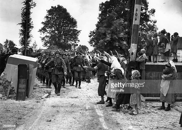 Troops of the German 'defence force' are welcomed as they march across the border at Wald Haenst into Czechoslovakia