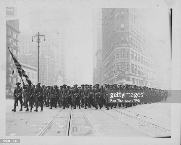 US troops of the machine gun squad marching along 2nd Avenue in a victory parade following World War One New York City circa 19181919