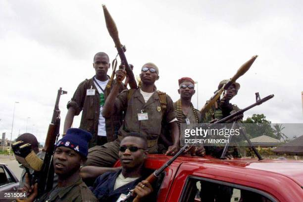 Troops of the so-called Forces Nouvelles of former Ivorian rebels post guard on the Boulevard de la Reine Pokou in Bouake in northern Ivory Coast 20...