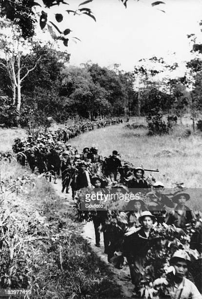 Troops of the South Vietnam Liberation Army marching towards the front along the Ho Chi Minh Trail Vietnam War August 1967
