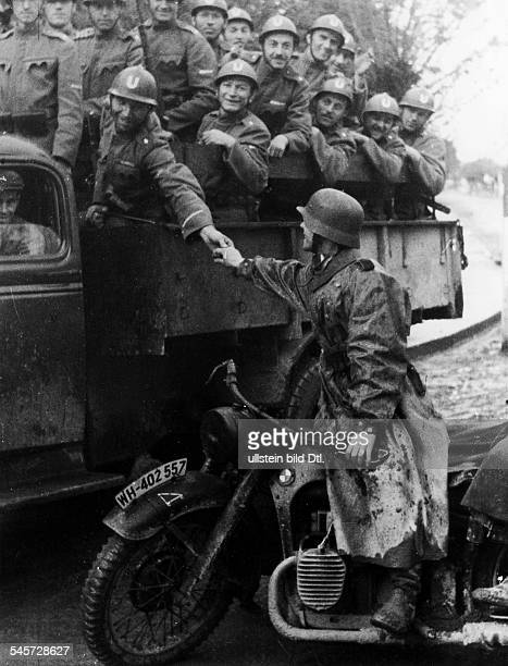 troops of the Ustasa displace German units in the fight against partisans on the lorry Ustasa soldiers on the motorbike a member of the German Armed...