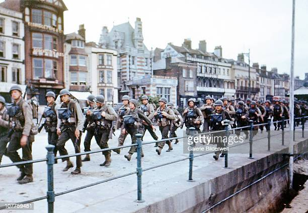 US troops on the Esplanade at Weymouth Dorset on their way to embark on ships bound for Omaha Beach for the DDay landings in Normandy June 1944