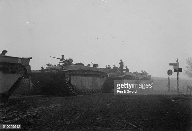 Troops on their way to Arnhem in buffalo tanks, France.