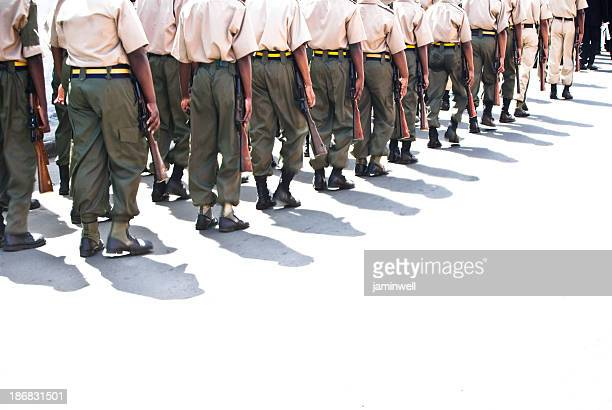troops or soldiers marching in line - paramilitary stock pictures, royalty-free photos & images