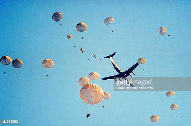 Troops parachuting from aircraft