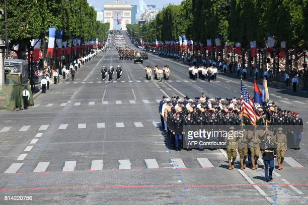 US troops parade during the annual Bastille Day military parade on the ChampsElysees avenue in Paris on July 14 2017 The parade on Paris's...