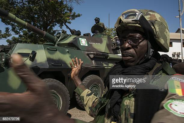 ECOWAS troops patrol around the Government House after the former President Yahya Jammeh fled the country in Banjul Gambia on January 23 2017 Yahya...